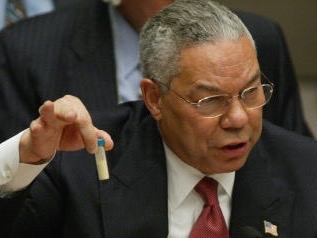 "US Secretary of State Colin Powell holds up a vial that he said was the size that could be used to hold anthrax as he addresses the United Nations Security Council 05 February, 2003 at the UN in New York. Powell urged the UN Security Council to say ""enough"" to what he said was Iraq's 12 years of defiance of international attempts to destroy its chemical and biological weapons. AFP PHOTO/Timothy A. CLARY"